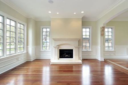 hardwood: Living room in new construction house with fireplace