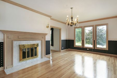 Living room in remodeled home with fireplace photo