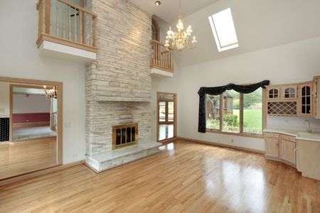 stone fireplace: Living room in remodeled home with two story fireplace