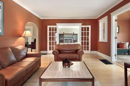 Living room in luxury home with orange walls photo