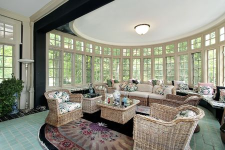 luxury living room: Living room in luxury home with wall of windows Stock Photo