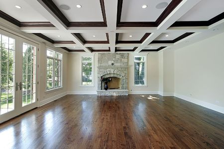 stone fireplace: Living room in new construction home with wood ceiling squares