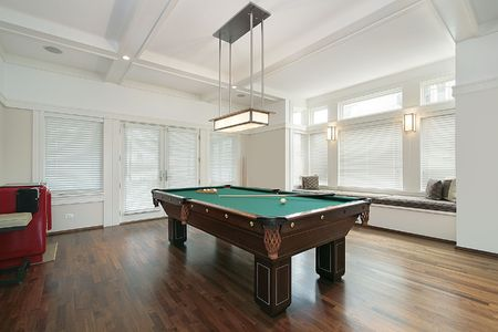pool room: Pool room in luxury home with wall of windows