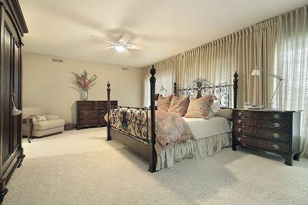 Master bedroom in condominium with dark wood furniture Stock Photo - 6738370