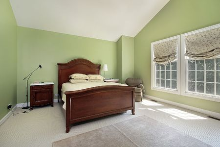 Master bedroom in suburban home with green walls photo