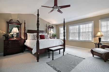 Master bedroom in townhome with dark wood furniture photo