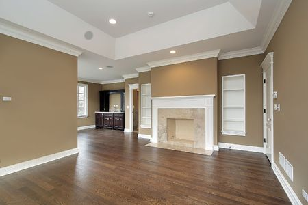 living room interior: Master bedroom in new construction home with marble fireplace