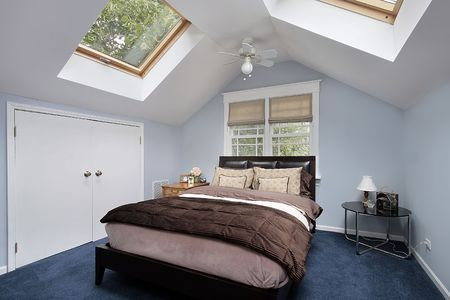 Master bedroom in suburban home with skylights Stock Photo - 6738307