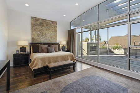 Master bedroom in luxury home with large deck Stock Photo - 6739082