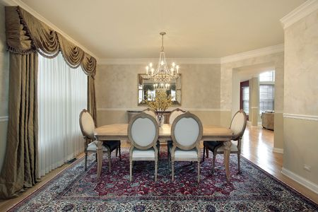 Formal beige dining room in subrban home photo