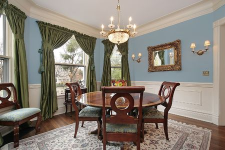 dining table and chairs: Dining room in luxury home with round wood table