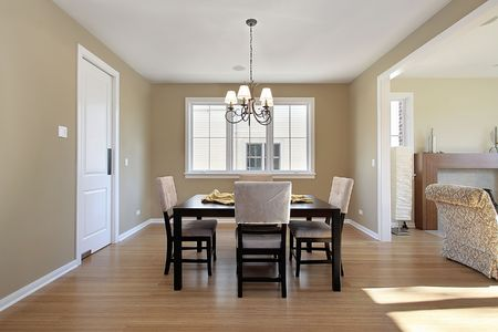 Dining room in new construction home with family area view photo