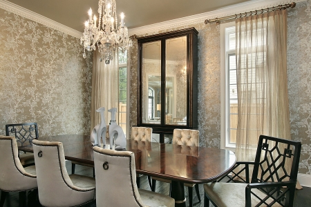 Dining room in luxury home with gold walls photo