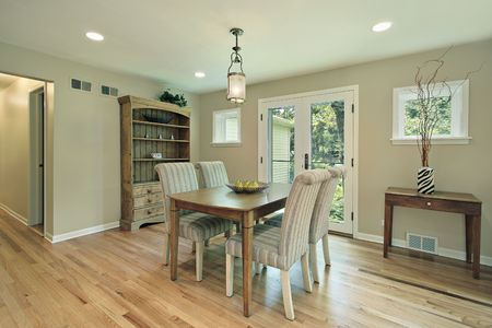 Dining room in suburban home with doors to patio photo