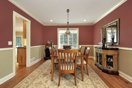 living room interior: Dining room in suburban home with two toned walls Stock Photo