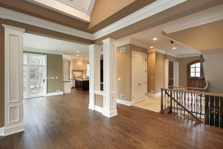 Foyer and family room in new construction home photo