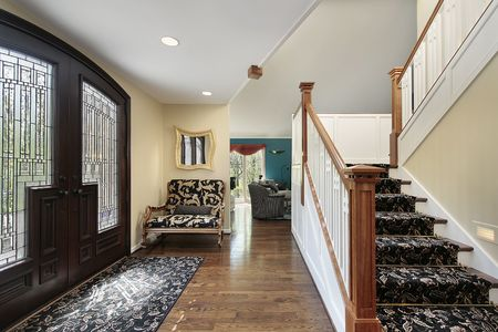 Foyer in suburban home with leaded glass doors photo