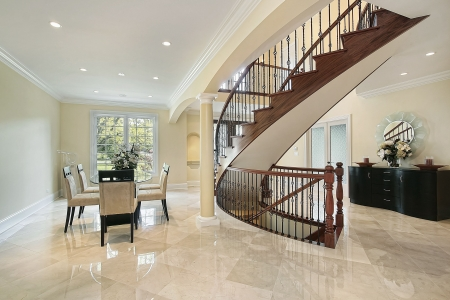 home lighting: Foyer in luxury home with curved staircase