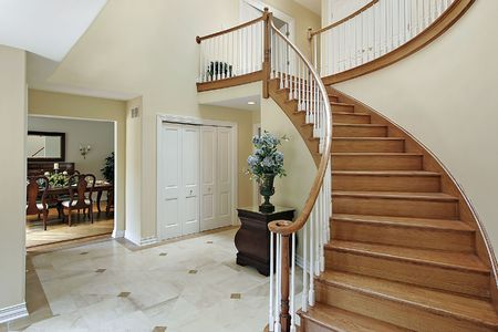 Foyer in suburban home with curved staircase