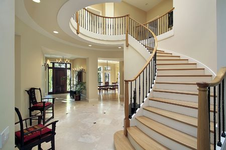 chandelier: Foyer in luxury home with curved staircase