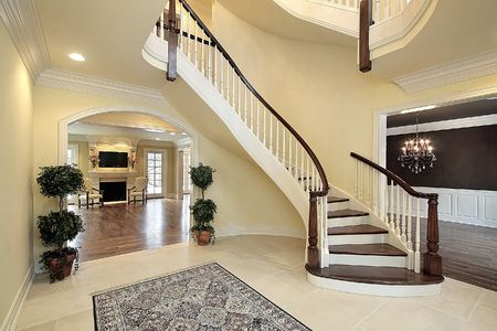 luxuries: Foyer with curved staircase in new construction home