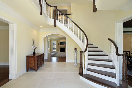 Foyer with curved staircase in new construction home photo