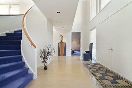 Foyer in luxury home with spiral staircase photo