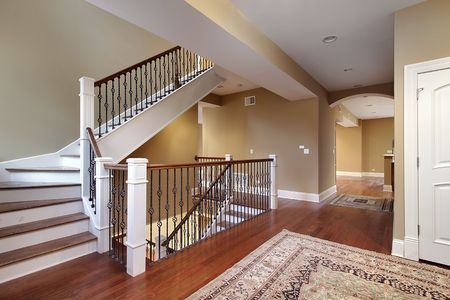 Foyer in new construction home with cherry wood floors photo