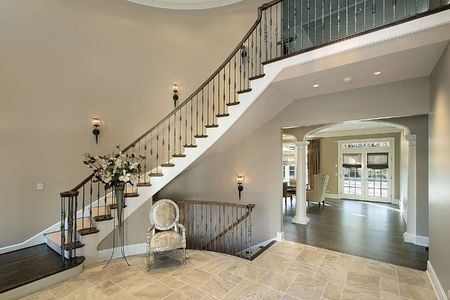 Foyer in luxury home with curved staircase Stock Photo - 6739028