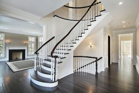 luxuries: Foyer in new construction home with curved staircase Stock Photo