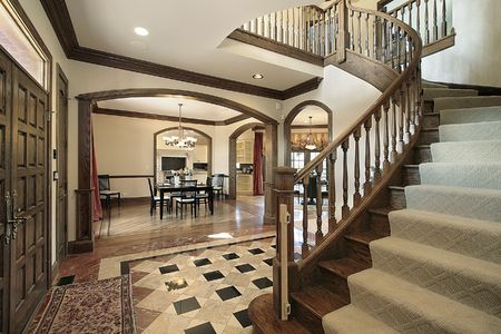 Foyer in luxury home with floor design photo