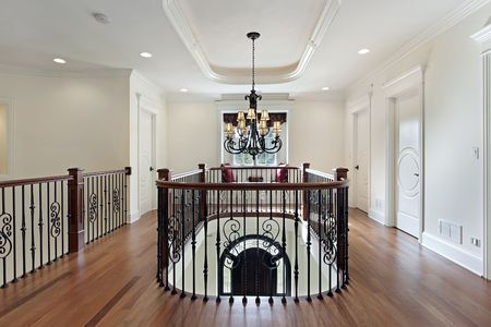 second floor: Second floor landing with wood and brass railing Stock Photo