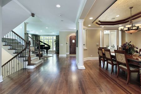 home lighting: Foyer in luxury home with dining room view