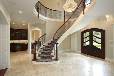 Foyer in new construction home with curved staircase photo