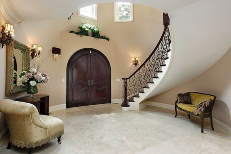 elegant staircase: Foyer in luxury home with curved staircase