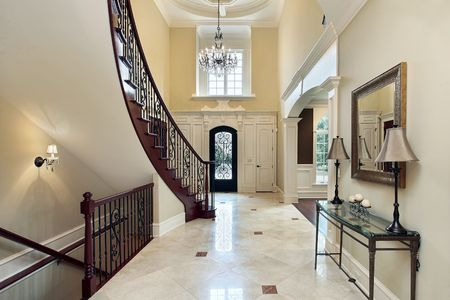 elegant staircase: Foyer in luxury home with second floor window Stock Photo
