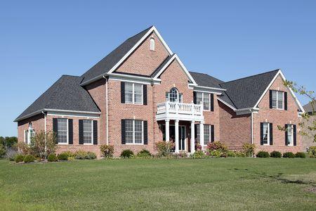 Luxury brick home with white front balcony Stock Photo - 6739518