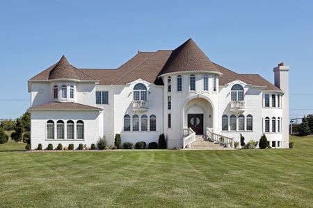 Large luxury white home with front turret Stock Photo