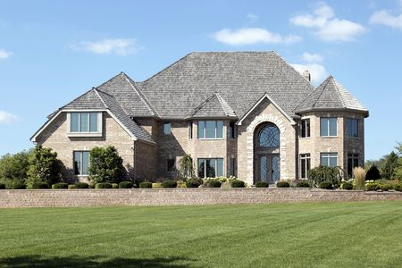 Luxury brick home with cedar shake roof Stock Photo - 6739496