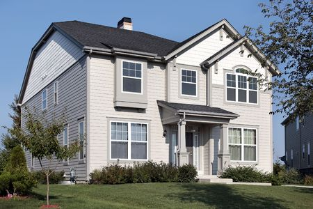 Home in suburbs with gray and white siding photo