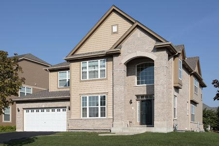 Brick home in suburbs with arched entrance Stock Photo - 6739287