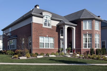 Front view of suburban brick home with columns Stock Photo - 6739120
