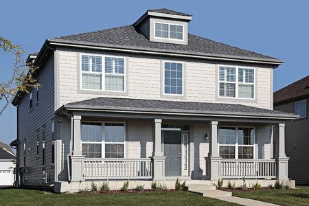 Gray home in suburbs with front porch
