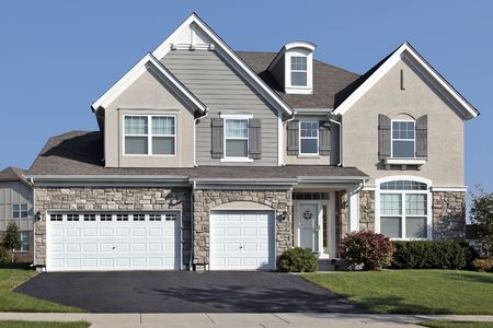 Home in suburbs with three car stone garage Stock Photo - 6739091