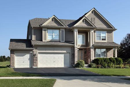 Brick home in suburbs with arched entrance Stock Photo - 6739097