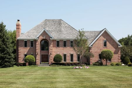 Luxury brick home in suburbs with arched entry Stock Photo - 6739298