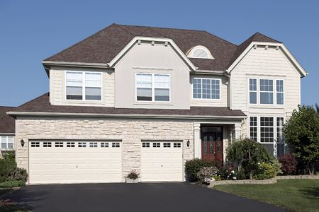 Home in suburbs with three car stone garage Stock Photo - 6739102