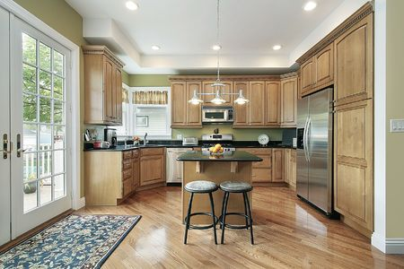 Kitchen in suburban home with small island photo