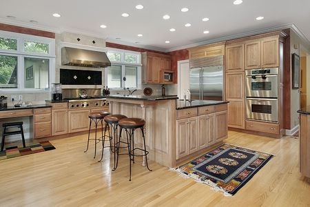 cabinetry: Kitchen in luxury home with oak cabinetry Stock Photo