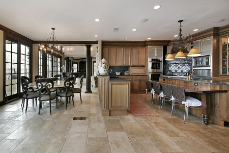 kitchen cabinets: Country kitchen in luxury home with eating area